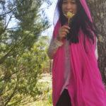 Jendhamuni holding flowersm